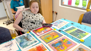 A young patient enjoying a Paintings in Hospitals art workshop at The Noah's Ark Children's Hospital for Wales