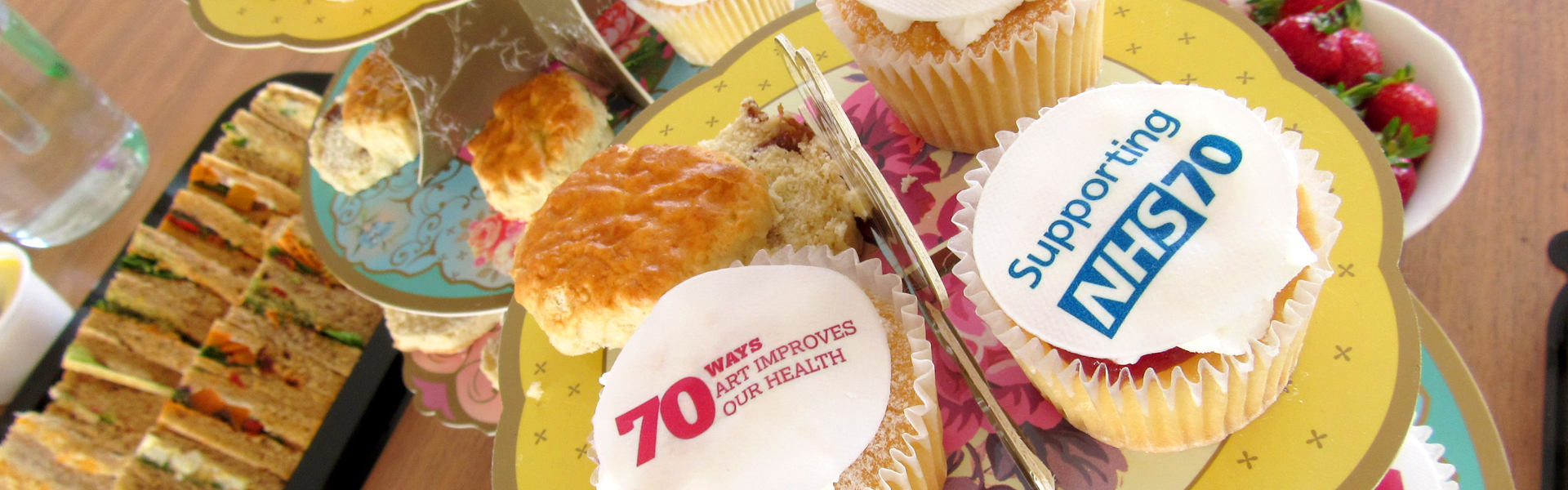 Cakes and sandwiches with NHS70 and Paintings in Hospitals logos on them. Part of our celebration of the NHS 70th birthday.