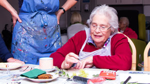 Resident enjoying a Paintings in Hospitals art workshop at Arthur Rank Hospice